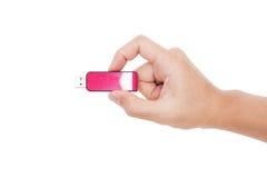 Close-up Hand holding USB data storage flash drive, isolated on white background Stock Images