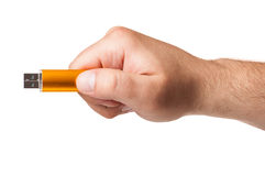 Close up with a hand holding an USB stick Royalty Free Stock Photography