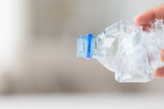 Close up of hand holding used plastic bottle Royalty Free Stock Image