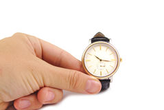 Close up of hand holding watch, isolated on white background. Time concept Royalty Free Stock Photo