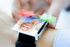 Close up of hand with incoming call on smart watch. Business, communication, technology and people concept - close up of women hands setting smart watch with royalty free stock photos