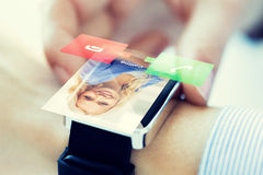 Close up of hand with incoming call on smart watch royalty free stock images