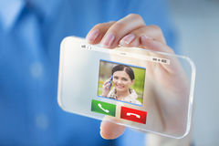 Close up of hand with incoming call on smartphone Stock Photography