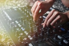 Close up of Hand Increasing Sound of DJ Instrument, Moving Fader. royalty free stock photo
