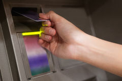 Close up of a hand inserting a credit card Royalty Free Stock Images