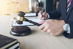 Close up of hand, Judge hitting gavel and scales of justice, Boo Stock Image