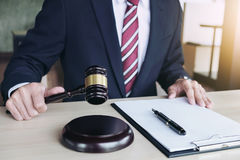 Close up of hand, Judge hitting gavel and scales of justice, Rep Stock Photo