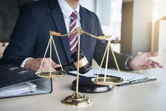 Close up of hand, Judge hitting gavel and scales of justice, Rep Stock Image