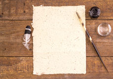 Close up of hand made elephant dung paper, ink, pen and magnifie Royalty Free Stock Photo