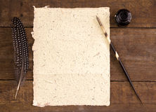 Close up of hand made elephant dung paper, ink, quill pen Royalty Free Stock Photo