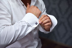 Close up of hand man how wears white shirt and cufflink Royalty Free Stock Photos