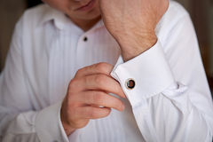 Close up of a hand man how wears white shirt and cufflink stock image