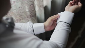 Close up of a hand man how wears white shirt and cufflink stock video
