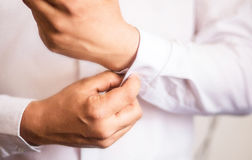 Close up of a hand man how wears white shirt Royalty Free Stock Photo