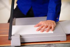 Close up of hand man over the guillotine, working on the guillotine, cutting paper.  Stock Photography