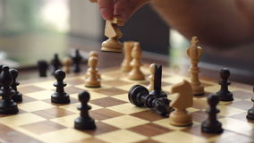 Close-up of the hand of a man playing chess. stock footage
