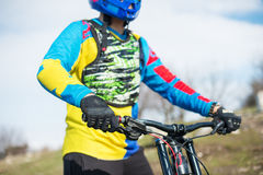 Close-up of a hand Man racer mtb cyclist in sport gloves getting ready for a race firmly holds the steering wheel royalty free stock photography