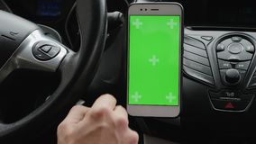 Using a green screen smartphone inside a car stock video