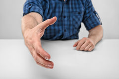 Close-up hand of man stretched out to greet. Royalty Free Stock Photo