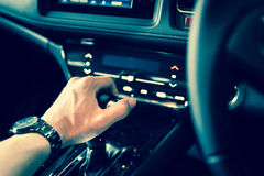 Close up of hand on manual gear shift knob for car industrial co. Ncept royalty free stock images