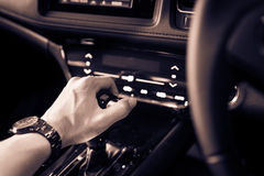 Close up of hand on manual gear shift knob for car industrial co. Ncept royalty free stock image
