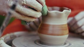 Close-up, The Hand of the Master Teaches His Apprentice Pottery Art