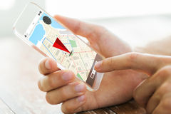 Close up of hand with navigator map on smartphone. Navigation, location, technology and people concept - close up of male hand holding transparent smartphone Royalty Free Stock Image