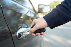 Close-up of hand opening a car door by key royalty free stock photos