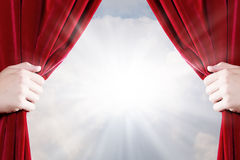 Close up of hand opening red curtain Stock Photos