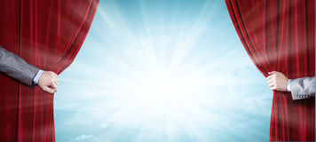 Close up of hand opening red curtain Royalty Free Stock Photos