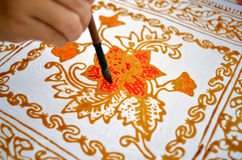 Close up of hand painting batik Stock Images