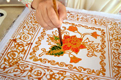 Close up of hand painting batik Royalty Free Stock Images