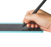 Close up Hand on pen and mouse pad Royalty Free Stock Images