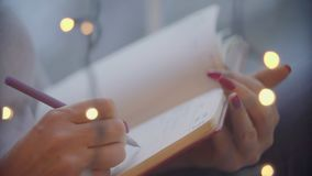 Close-up of hand pen writes in a notebook stock footage