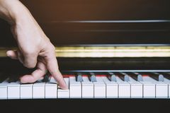 Close up of hand people man musician playing piano keyboard with selective royalty free stock images