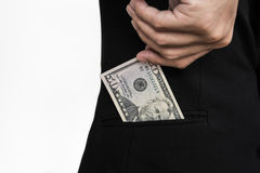 Close-up hand picking cash from pocket, selective focus on cash Royalty Free Stock Image
