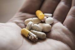 Close up hand with pills Stock Photos