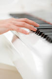 Close up of hand playing piano Stock Photos