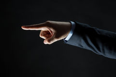 Close up of hand pointing finger to something Stock Photography