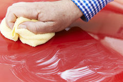 Close Up Of Hand Polishing Car Hood Using Cloth Royalty Free Stock Image