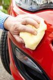 Close Up Of Hand Polishing Car Using Cloth Royalty Free Stock Photos