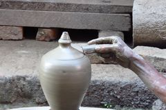 Close-up of the hand of a local potter creating a clay vase, Bhaktapur, Nepal royalty free stock image