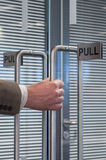 Pull open the door Stock Photo