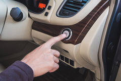 Close-up hand push button in modern car Royalty Free Stock Photos