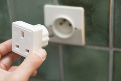 Close Up Of Hand Putting Electric Travel Adapter Into European S Royalty Free Stock Photography