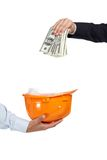 Close up of hand putting money in helmet Royalty Free Stock Image