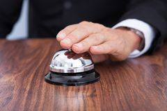 Close-up of hand ringing service bell Stock Image