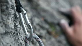 Close up of a hand rock climbing in nature stock video footage