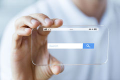 Close up of hand with search bar on smartphone Royalty Free Stock Photos