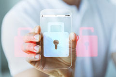 Close up of hand with security lock on smartphone Royalty Free Stock Image